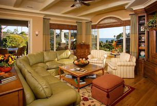 Traditional Living Room with Standard height, Ceiling fan, picture window, Hardwood floors, double-hung window, Exposed beam