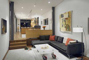 Contemporary Great Room with Built-in bookshelf, Sunken living room, Laminate floors, High ceiling
