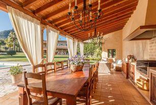 Mediterranean Porch with Outdoor kitchen, exterior stone floors