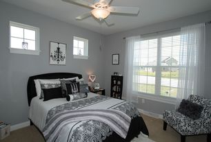 Traditional Guest Bedroom with Ikea Teresia Sheer Curtain, Carpet, flush light, Nail Button Chair - Fiorenza Black & White