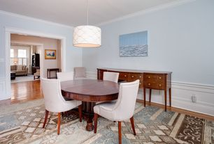 Traditional Dining Room with Crown molding, Hardwood floors, Pendant light, Wainscotting