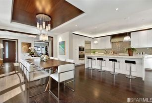 Contemporary Dining Room with Brilliant Glass Tiles Ocean Gray Glass 3x6 Subway Tile, Chandelier, Trey ceiling