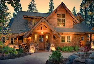 Rustic Exterior of Home with Concrete walkway, Exterior lighting, Cedar shingle siding, Naturalistic landscaping