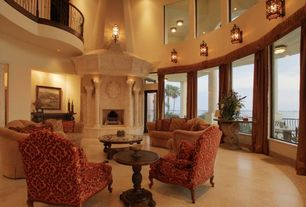 Mediterranean Living Room with Concrete tile , Cathedral ceiling, Console with scroll base, Loft, Columns, French doors