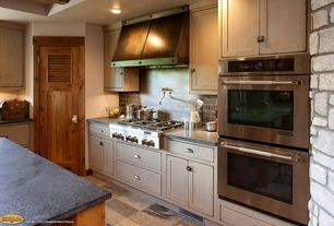 Rustic Kitchen with European Cabinets, Louvered door, Kitchen island, Standard height, stone tile floors, Wall Hood, L-shaped
