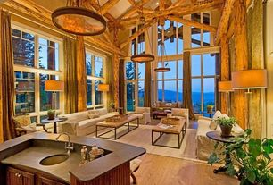 Rustic Great Room with Chandelier, Elk lighting barringer tan mica shade 4-light pendant, Transom window, Cathedral ceiling