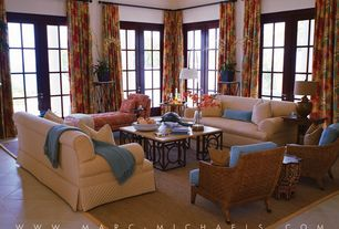 Tropical Living Room with Crown molding, High ceiling, Glazed porcelain floor tile, French doors, stone tile floors