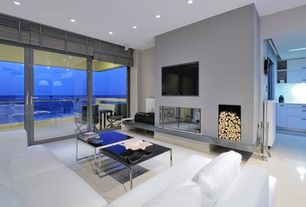 Contemporary Living Room with French doors, Concrete floors