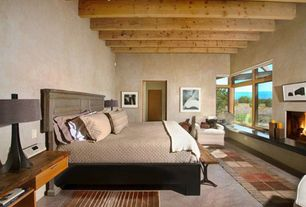 Eclectic Master Bedroom with Exposed beam, Built-in bookshelf, Carpet