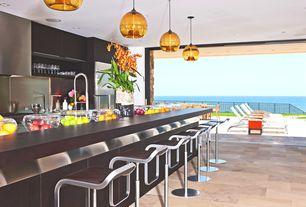 Contemporary Bar with Built-in bookshelf, slate tile floors, Pendant light