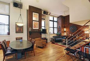 Contemporary Great Room with Standard height, Hardwood floors, interior brick, double-hung window, Ceiling fan, can lights