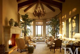 Traditional Living Room with Exposed beam, Cathedral ceiling, Hardwood floors, Large potted plants, Chandelier