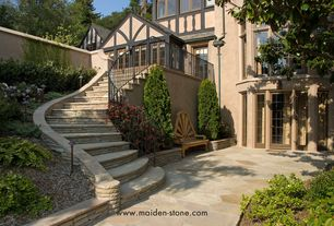 Traditional Landscape/Yard with Pathway, exterior stone floors, Deck Railing, Casement, French doors, Fence
