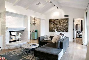 Eclectic Living Room with Hardwood floors, Fireplace, Standard height, Exposed beam, brick fireplace, flush light