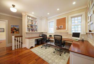 Traditional Home Office with Hardwood floors, flush light, Built-in bookshelf, Crown molding