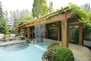 Traditional Patio with Trellis, Fire pit, Pathway, Outdoor kitchen, Fountain, Fence, exterior tile floors