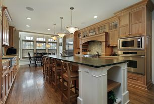 Contemporary Kitchen with Slate counters, Kitchen island, full backsplash, Built In Refrigerator, Farmhouse sink, wall oven