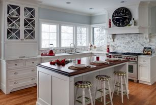 Traditional Kitchen with Flat panel cabinets, Custom hood, L-shaped, Wood counters, Standard height, full backsplash, Paint 1
