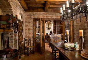 Mediterranean Wine Cellar with terracotta tile floors, High ceiling, Built-in bookshelf, Exposed beam, Chandelier