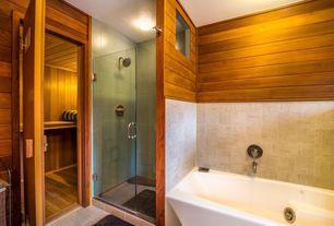 Contemporary Master Bathroom with flush light, stone tile floors, drop in bathtub, frameless showerdoor, Standard height
