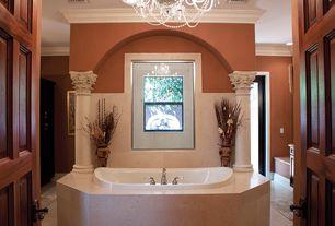 Modern Master Bathroom with Flush, Chandelier, Columns, Crown molding, Master bathroom, limestone tile floors, specialty door