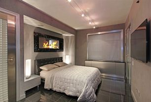 Modern Master Bedroom with complex granite tile floors, Glass panel door, Track lighting, flush light