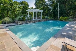 Traditional Swimming Pool with exterior stone floors, Fence, Trellis, Lap pool