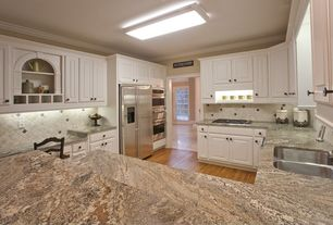 Traditional Kitchen with Complex granite counters, Inset cabinets, Raised panel, Crown molding, flush light, Stone Tile