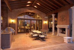 Mediterranean Patio with Transom window, French doors, exterior stone floors, Arched window, Outdoor kitchen