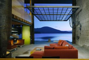Contemporary Living Room with Counterbalance, picture window, Cinder block walls, Hayden lake, floor to ceiling window, Paint