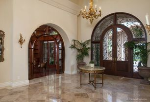 Mediterranean Entryway with simple marble tile floors, French doors, Wall sconce, Chandelier, Transom window