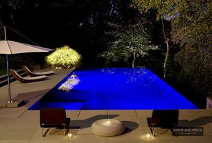 Contemporary Swimming Pool with Infinity pool, exterior stone floors, Raised beds