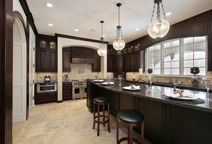 Kitchen with U-shaped, specialty door, limestone tile floors, Stone Tile, MS International Jura Grey Limestone, Breakfast bar