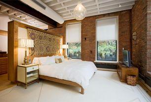 Eclectic Master Bedroom with flush light, interior brick, Exposed beam, Pendant light, Hardwood floors