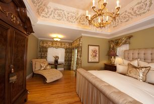 Traditional Master Bedroom with French doors, Chandelier, Hardwood floors, Crown molding, flush light