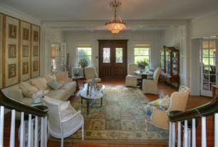 Traditional Living Room with Built-in bookshelf, Hardwood floors, flush light, Chair rail, Glass panel door, Wainscotting