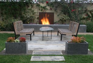 Contemporary Patio with Fence, exterior tile floors, Fire pit, Gate, Raised beds