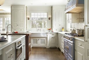 Country Kitchen with Wood counters, Flat panel cabinets, double oven range, Pergo presto, Simple marble counters, L-shaped