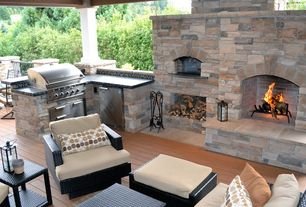 Mediterranean Patio with Built-in outdoor kitchen, Outdoor kitchen, Wood beams, Treated wood floor, Deck Railing