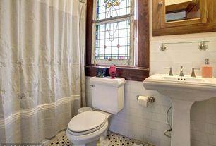Traditional Full Bathroom with tiled wall showerbath, Pedestal sink, penny tile floors, Glass panel, Flush