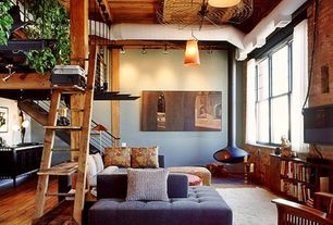 Rustic Living Room with Built-in bookshelf, Paint, Ceiling fan, Columns, flush light, Standard height, Wood Stove fireplace