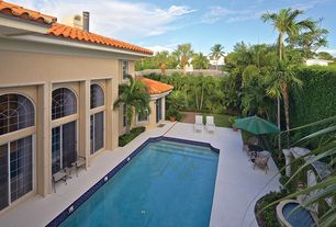 Mediterranean Swimming Pool with Fountain, Transom window, Fence, Lap pool, exterior stone floors, Pathway, Arched window