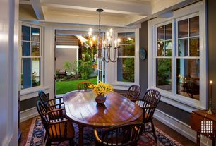 Traditional Dining Room with French doors, Exposed beam, Hardwood floors, Crown molding, Chandelier