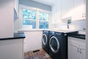 "Modern Laundry Room with Emser tile classica 3"" x 6"" glossy ceramic wall tile in white, Brick floors, Built-in bookshelf"