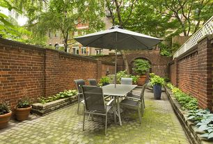 Traditional Patio with exterior stone floors, exterior brick floors, Raised beds, Fence