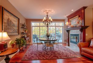 Mediterranean Dining Room with Built-in bookshelf, insert fireplace, picture window, Transom window, can lights, Fireplace