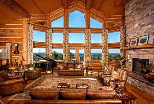 Rustic Living Room with Leather sofa, Hardwood floors, Floral curtain, stone fireplace, Columns, Fireplace, French doors