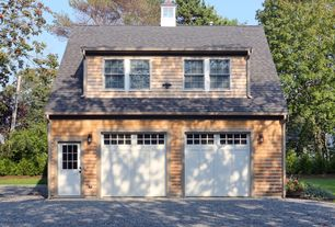Cottage Garage with High ceiling, specialty door, Concrete floors