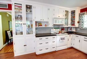 Traditional Kitchen with High ceiling, Flat panel cabinets, Glass panel, Inset cabinets, L-shaped, Penny Tile, Crown molding