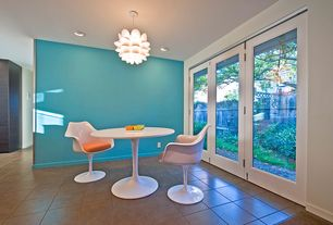 Contemporary Dining Room with flush light, Standard height, French doors, Concrete tile , picture window, can lights